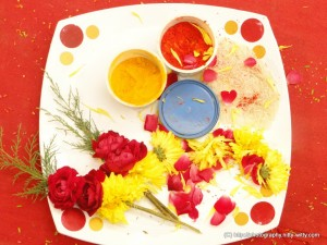 puja thali (dish) with roses and kumkum